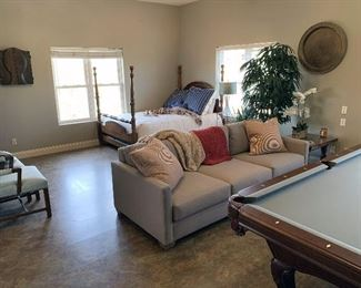 Dart Board, queen size four poster bed, beige canvas couch (very robust and great quality), new (less than one month old) slate pool table with charcoal felt (very heavy), lamps, antique end table, throw blankets, pillows, fake plants, etc.