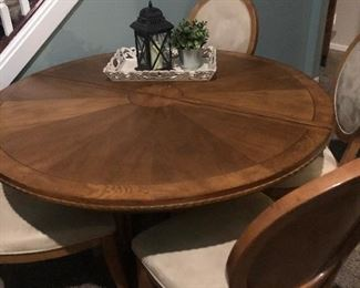 Wow! THIS 6 setting table is the real deal! It is incredibly sturdy, solid, and heavy. It is real wood. This is the mother of all tables. The chairs have been professionally cleaned (not that they needed it!). We also have another leaf for this. It is a SIX CHAIR PIECE! See dimensions below:  1 leaf: 17.5 inches wide  54 inches across (without leaf)  6 chairs total  Asking $650 for table, leaf, chairs or best offer
