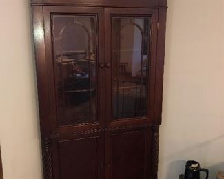 Antique walnut corner cabinet