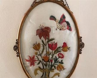 Antique brass oval needle point art.