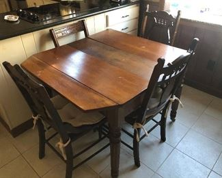 Walnut table and 5 chairs