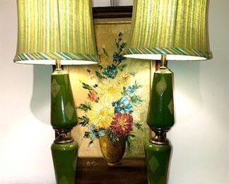 Incredible, hard to find, pair of 1950's green ceramic lamps. Shades not original but work beautifully with them. Great condition!