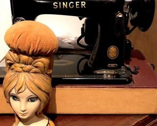 Vintage Singer sewing machine with accessories and a vintage, lady head pin cushion. NICE!