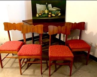 Awesome set of 4 Mid-Century solid wood chairs. Very sturdy and still have the original coral fabric with metallic threads! Excellent condition.