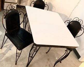 Sweet and elegant old, heavy wrought iron table with four chairs. Absolutely great find with lots of potential! They don't make them like this anymore!