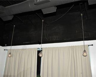 9. Three 3 Single Globe Pendant Lights