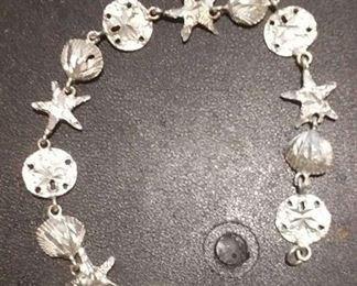https://www.ebay.com/itm/124156078617RX4152003 STERLING SILVER 925 7 INCH SEA SHELL, SAND DOLLAR, STAR FISH BRACELET  RX BOX 1 RX415203 $19