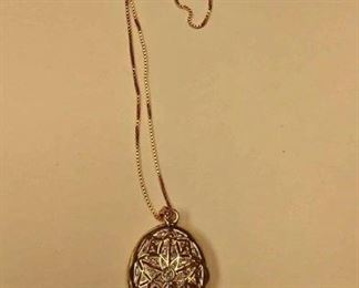 https://www.ebay.com/itm/124135610774Rxb010 STERLING SILVER LOCKET & CHAIN 18 INCH CHAIN (ITALY) LOCKET (CHINA) BOTH ITEMS GOLD PLATED TOTAL WEIGHT 9.2 GRAMS  $20