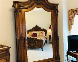 """Louis XV French antique mirrored carved walnut wedding armoire with ornate cartouche, single beveled mirror, bottom pulls out to secret drawer, H 104"""", L 55"""", W 22"""""""