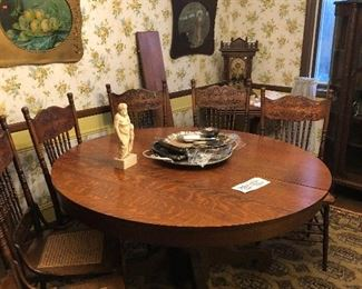 Solid oak round pedestal table and 6 Cain & Spindle chairs with decorative ...