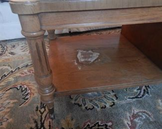 A view of wood damage on Thomasville cocktail table