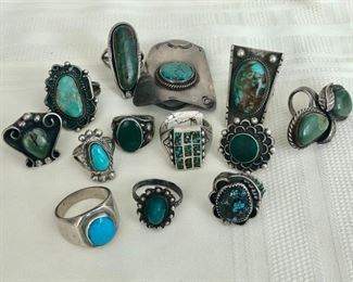 Selection of vintage Native American rings and bolo holder.  Men's and women's rings.
