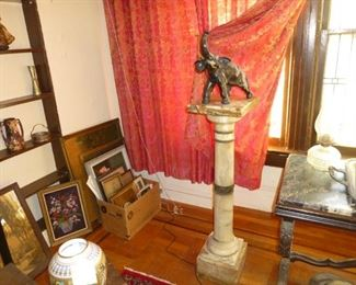 Marble pedestal with elephant metal statue