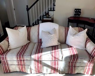 Upholstered camelback couch with additional slipcover