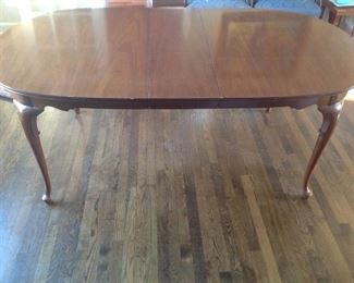 "Pioneer Furniture Queen Anne genuine mahogany table with two 12"" leafs and table pads included."