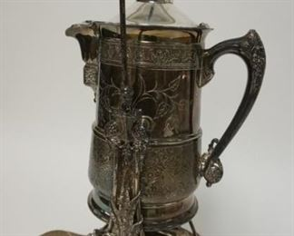1002   ORNATE TUFTS SILVER PLATED ICE WATER PITCHER WITH SWING STAND. 21 1/4 IN HIGH
