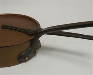 1007  TIN LINED COPPER COVERED PAN WITH CAST IRON HANDLES. 10 IN DIAMETER. LID DIE STAMPED C I A