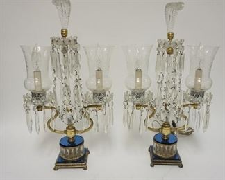 1009    PAIR OF CRYSTAL LAMPS WITH CUT HURRICANE SHADES, CUT PRISMS, BLUE GLASS DECORATION AND GLASS PLUME CRESTS. 21 1/2 IN H. ONE CORD IS CUT