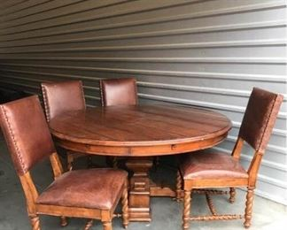 Solid wood round table with 8 chairs, Made by Stanley Furniture. The table comes with 4 leaf panels which make it larger to accommodate more seating.  The table measures 30 inches H X 64 inches around without the leafs.  With the 4 leafs shown in images 7,8,9, the table expands to 84 inches or 7 feet around.  There are some surface scratches on the table top but it does not take away from the look.  There are 8 chairs shown in image 10 (only 4 were shown in image 1 due to space limitations.  The chairs have grommets on the side which add to the rustic look.  The chairs are 41 inches high (back) and 22 inches W.  The seat pan is 19 inches D.  The seat cushion height to the ground is 19 inches.  There are minor scratches on the chairs but this adds to the character and look.