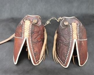 Leather Tapadero Stirrups. Tooled-leather with white lacing. https://ctbids.com/#!/description/share/314370