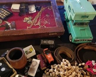 vintage leather dice shaker and dice. vintage shell necklaces, leather belts.