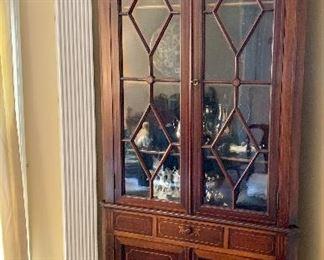 Vintage inlaid corner display cabinet.