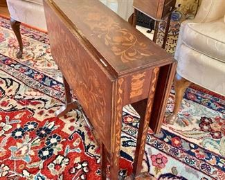vintage intricately inlaid drop leaf table with drawer.