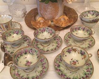 Beautiful porcelain china tea cups and saucers.  7 cups; 5 saucers.  No mark.