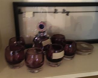 small drink glasses....small decanter.  It is not a set but looks close enough in color to match.