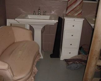 loveseat and Kohler sink with faucets