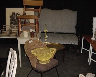 MCM wicker chair, Baltimore fancy chair, custom settee with carved arms, two Heywood-Wakefield side tables.