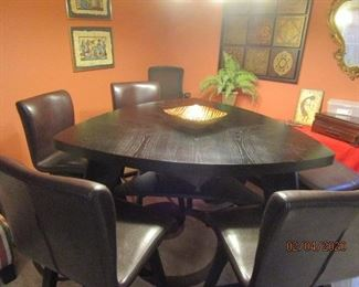 Beautiful 3 sided table.  4 Side chairs (tall) and I bench.  Seats 6-7.