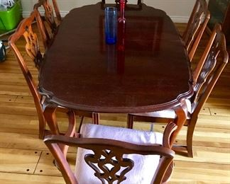 Pennsylvania house vintage cherrywood  dining room table with six matching chairs including two captains chairs and two extra leaves