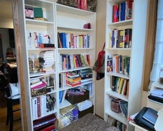White book cabinet and books