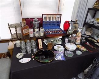 Silverplate flatware sets , variety of glassware, and vintage collectibles