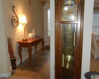 Stunning, Howard Miller solid wood grandfather clock - with a swan neck pediment & polished brass-finished pendulum.