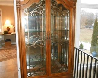 Gorgeous 7' tall wood, 2/door glass front + glass sides ornate cabinet with light