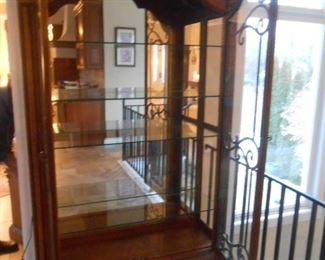 The cabinet comes with (4) glass shelves & ornate metal design in each glass door