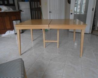 The mid-century table opens to (3) leaves....very nice