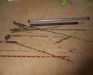 Numerous fishing rods of varying lengths