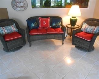 Two rockers with a settee in the basement family room