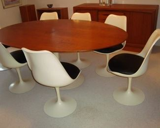 Saarinen dining room table and eight tulip chairs