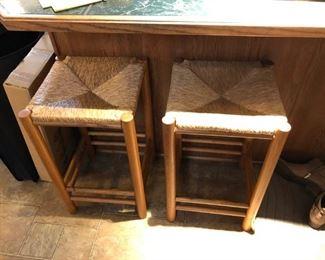 Two unique straw bound stools