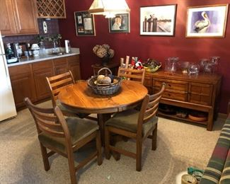 Solid oak kitchen table with four chairs and a leaf; chest filled with treasures; artwork and wooden bowls and accessories