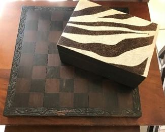 ZEBRA SKIN COVERED BOX OF CHESS PIECES AND WOOD BOARD