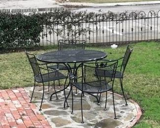 5 piece wrought iron table and chairs $125