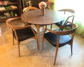 Mid-century/Danish modern formica table and chairs with matching legs.