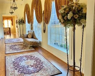 Pair Art & Commerce torchiers with custom designed floral  arrangement; three hand tufted silk & wool 5x8  area rugs