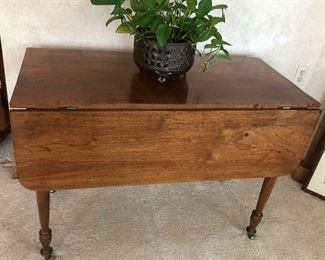 Drop leaf table with brass casters