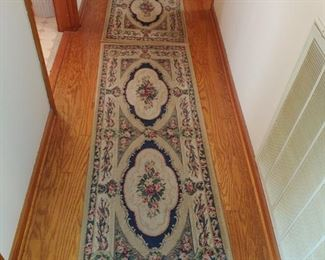 Pretty rugs going down the hall